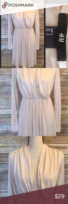 H&M Dress Sz SM H&M Dress. Beautiful light blush color. Has long sleeves. Feminine and flattering crossover top. Excellent condition. Size Small. Bundle and save. Happy Poshing.  Work Dresses, Casual Dresses H & M Dress, H&M Dresses Midi