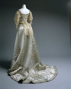 Ball gown Design House: House of Worth Date: 1900–1905 Culture: French Medium: silk, cotton, metallic thread, glass, metal Accession Number: 1979.251.4a, b