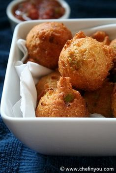 Hushpuppies (Fried Cornbread) Recipe - Simple to make, quick to put together and budget friendly, these cornmeal fritters are crispy on the outside and spongy/fluffy inside.