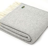 FISHBONE - SILVER GREY A gorgeous Pure New Wool fishbone weave throw in the soft warm shade softly finished with a generous cream fringe A