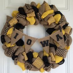 Handmade burlap wreath. This is the perfect gift for any sports fans front door (Can be customized to any team)! This wreath is made out of burlap including black and yellow with chevron ribbon attached. The banner is made out of burlap with wooden letters painted black. It is attached with miniature clothespins. Click on the smaller pictures to see a nice close up.  This wreath is approximately 23 inches in diameter. All wreaths are handmade and may vary slightly from the picture. If you…