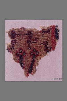 Fragment Date: probably 14th century Geography: Spain Culture: Islamic Medium: Wool (warp, weft and pile); single-warp (Spanish) knotted pile Accession Number: 1972.120.1