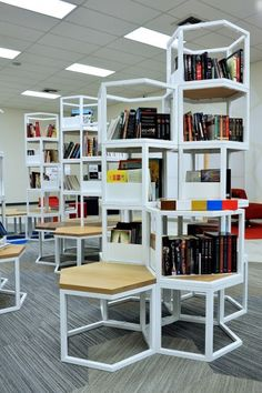 Locke Jetspace: L.A. School Library of Future (Oct. 23, 2014, article in School Library Journal) - minimal book shelving in futuristic school library