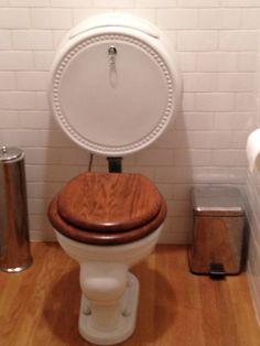 Original toilet with round tank (!) in 1914 Portland mansion.