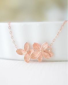 The Rose Gold Double Flower Necklace by JewelMint.com, $36.00