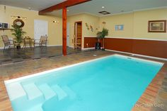 nice indoor pool with slate or travertine tiles. A Pearl's Splash cabin in Sevier County  Sevierville   photo  854