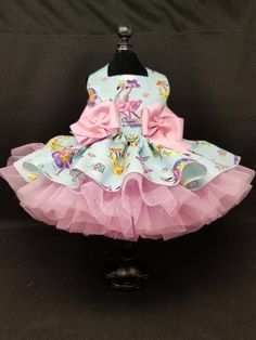Pale blue cotton fabric with fun flamingos at the beach. Very full skirt with two pink petticoats for a very full look. I added two double pink bows centered with pink flamingo charms. Custom sized to your measurements up to 16 inch girth and 12 inch length. Please provide these measurements in the