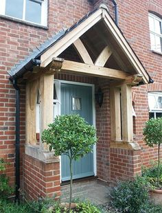 Take a look at our gallery of various styles of oak porches Front Door Canopy, Front Door Porch, Porch Roof, Front Doors, Porch Overhang, House With Porch, House Front, Porches, Porch Extension