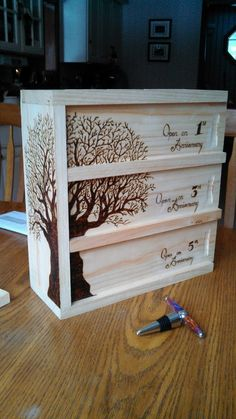 Wood burned 3 bottle wine box. Who wouldn't like to recieve this as a present? A really beautiful piece of work & one lucky Dad ;)