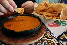 Chili's Skillet Queso  ingredients  16 oz Velveeta cheese  1 (15 oz) can Hormel No-Bean Chili  2 tsp Paprika  1 Tbsp Lime Juice  1/2 tsp Cayenne Pepper, ground  1/2 tsp Cumin, ground  1/2 lb Ground Beef (cooked)