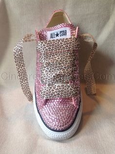 3a38c2ada0b4 This is for a pair of totally covered pink Low OX All Star Converse. Each  and every single section of the shoe is covered in pink stones as