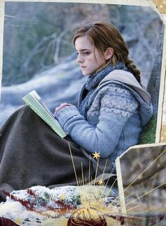 Hermione.. deep in thought, paused while reading a book in the forest. me