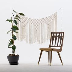 This cream hanging is strung on organic twine. Each piece is individually hand cut and woven by hand according to your dimensions.  The curtain