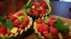 Use small melons cut in half and yield personal fruit cups