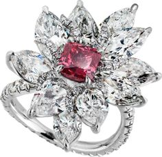 Radiant-cut Fancy Purplish Red diamond mounted with six marquise and four pear-shaped diamonds,highlighted by white pave diamonds, handcrafted in platinum