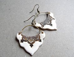"""Faux ivory earrings lotus mandala tribal by MoonsafariBeads, Faux ivory earrings handmade from polymer clay, stamped with a lotus mandala pattern. The earrings are hung on brass wire and antique brass tone ear hooks.    Beautiful, rich ethnic look, you will love these earrings.    They measure are about 1.5"""" wide and 2"""" long( including the ear hooks)."""