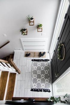 DIY Split Level Entry Makeover- I LOVE this entry. The oversize door, scandi influence and that shoe storage! Entry Way Decor | Foyer Decor | Home Decor | Rustic | Farmhouse | Farm House | Country Home | Entryway Ideas | Foyer Ideas| House Ideas | Apartment Décor #entryway #homedecor #homeideas #entry #foyer #entrance