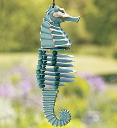 Seahorse Wind Chime...The only animal species in which the male gives birth, the seahorse is a symbol of loving fatherhood. Monogamous for life, they mate during full moons, making musical sounds while doing so. Their prehensile tails (natural Fibonacci spirals) link couples together to navigate turbulent waters in pairs. The only fish that can swim backward, they can also change color at will. Pretty impressive, cute little guy!