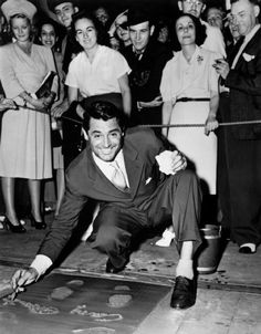 Leaving his footprints at Grauman's Chinese Theater in Hollywood.