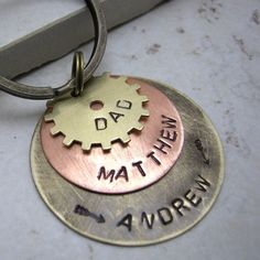 Gear Personalized Hand Stamped Key Chain 3 Layers by riskybeads. $24.95, via Etsy.