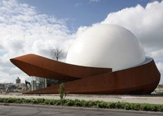 Dutch studio Archiview gave this planetarium-like cinema in Groningen a spiralling dome structure, which invites comparisons with hats, eyeballs and UFOs. Unique Buildings, Interesting Buildings, Amazing Buildings, Beautiful Architecture, Architecture Details, Architecture Design, Planetarium Architecture, Dome Structure, Tableau Design