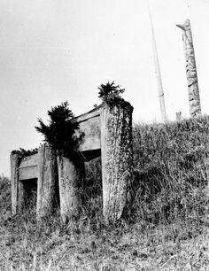 Double mortuaries with the frontal pole of the Bone House in the background at the top of the hill.