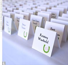 The couple's signature green horseshoe logo appeared on many wedding stationery pieces, including their white, tented escort cards. Irish Wedding, Fall Wedding, Our Wedding, Wedding Stuff, Horseshoe Logo, Table Cards, Youre Invited, Wedding Stationary, Wedding Website