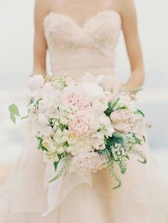 """Free Form Bouquet Which Includes: Ultra Light Pink Peonies, White Ranunculus, Stock, Fringed Tulips, Snow Bells, Lily Of The Valley, Additional White Florals & Greenery/Foliage............"