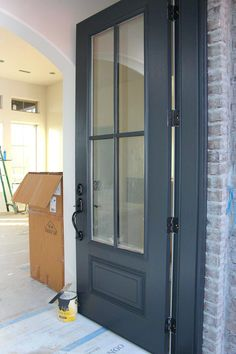 Door painted in Benjamin Moore Wrought Iron. One of the best dark door and trim … Door painted in Benjamin Moore Wrought Iron. One of the best dark door and trim colors. by alisha - Door Dark Doors, House Design, House, Updating House, Front Door Colors, Painted Doors, House Exterior, New Homes, Front Door