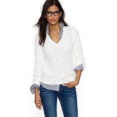 light denim shirt under white sweater with darker jeans