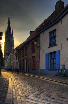 A road in Bruges, the capital and largest city of the province of West Flanders in the Flemish Region of Belgium.