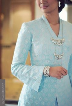 I love kebaya! Its look elegant and comfortable! Short length kebaya for my solemnization pair with mermaid cut skirt and beading Hijab. And style with some necklace.