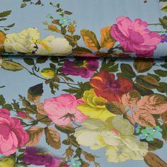 Stofje Tricot bloemenprint licht blauw