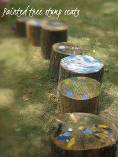 Painted tree stump seats.