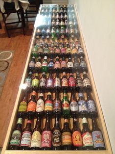 Not sure how much he's into beer pong. But it's pretty cool. Good luck to me (while making this) hiding this from the husband. Beer pong table made from 90 different beers!