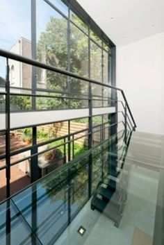Stalen loopbrug met glas, Vondelstraat   Kodde Architecten