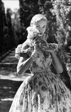 1950 Model in sheer dotted swiss, untypically rose-patterened, tied criss-cross with spaghetti strings by McCardell, photo by Louise Dahl-Wolfe, Harper's Bazaar,