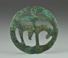 Amlash bronze horse fitting with horse, 1st millenium B.C. Loop backside, 4 cm diameter. Private collection
