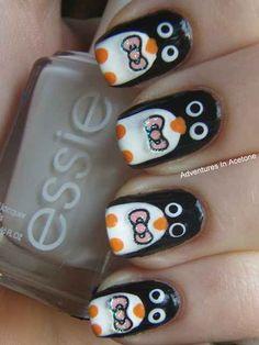 Cute penguin on fingernails.