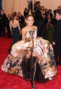 Sarah Jessica Parker in a Giles Deacon dress, Philip Treacy headpiece and Louis Vuitton boots | 2013 MET Gala