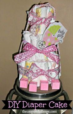 Learn How to Make a Girl Diaper Cake without breaking the bank. Find multiple diaper cake images to help you create the perfect diaper cake. Funny Birthday Gifts, Birthday Gifts For Women, Diy Diaper Cake, Diy Diapers, Cool Gifts For Women, Milestone Birthdays, Unique Presents, Novelty Gifts, Homemade Gifts