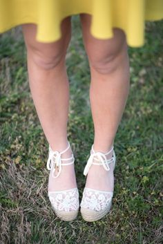 white lace wedges with ties up the ankle.