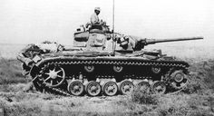 A Afrika Corp Panzer 3 Ausf M on the move through the open desert