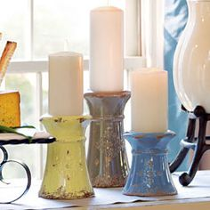 Amira Candlestands. Antiqued blue, mushroom and chartreuse pottery stands are accented by a rope detail and embossed emblem. www.denisecosgrove.willowhouse.com