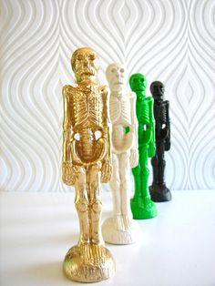 Halloween Skeleton Figurines Sold Separately in gold/white/green/black. $24.00, via Etsy.