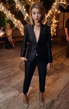 Sarah Hyland took the plunge in a chic black pantsuit as she posed for cameras during Cosmopolitan's 50th Birthday Celebration at Ysabel on Oct. 12, 2015 in West Hollywood.