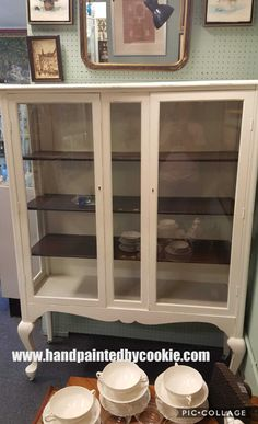 #vintage #painted #chinacabinet #storage #diningroom. Cabinet painted in sherwin williams creamy white. Shelves have been #stained in #generalfinishes java gel #stain #vintagefurniture #paintedfurniture #shabbychic #repurpose #diy #furnituremakeover #upcycle #distressed #farmhouse #rustic #country #cottage