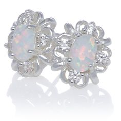 Opal and White Topaz Oval Swirl Stud Earrings in Sterling Silver (6 x... ($99) ❤ liked on Polyvore featuring jewelry, earrings, opal earrings, sterling silver jewelry, sterling silver pendants, opal pendant and swirl earrings