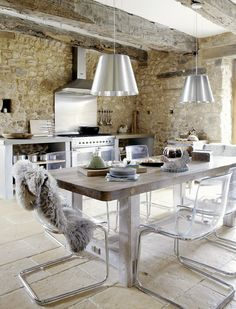 Modern rustic kitchen: Old stone walls, stainless steel stove and backsplash, rustic wood table, lucite and chrome dining chairs. Vintage House in Dordogne, France Estilo Country Chic, Lucite Chairs, Ikea Chairs, Lucite Furniture, Modern Furniture, Acrylic Furniture, Ikea Table, Cabin Furniture, Steel Furniture