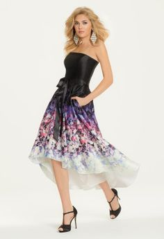 Adorable florals are the way to go for super chic and trendy prom dresses this year! This strapless cocktail dress is the perfect choice for prom owing to its ombre flow of flower patterns, unique high-low hemline, and of course the must-have pockets! This 50's inspired dress is perfect for the modern day prom girl who wants to take a different approach to her prom night look. Complement this charmuese dress with a t-strap sandal, pretty earrings, and a black clutch handbag for a stylish…